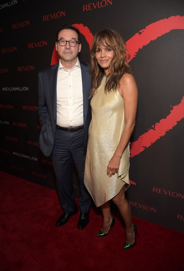 NEW YORK, NY - DECEMBER 01: Revlon Global Brand Ambassador Halle Berry and Revlon CEO Fabian Garcia celebrate the success of Revlon's 2nd Annual LOVE IS ON Million Dollar Challenge. (Photo by Jason Kempin/Getty Images for Revlon)
